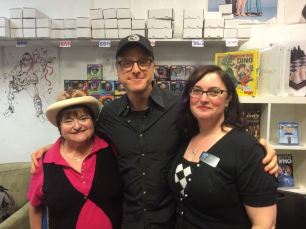 Alan with Parents Helping Parents representative Melanie and Illusive Comics & Games owner Anna.